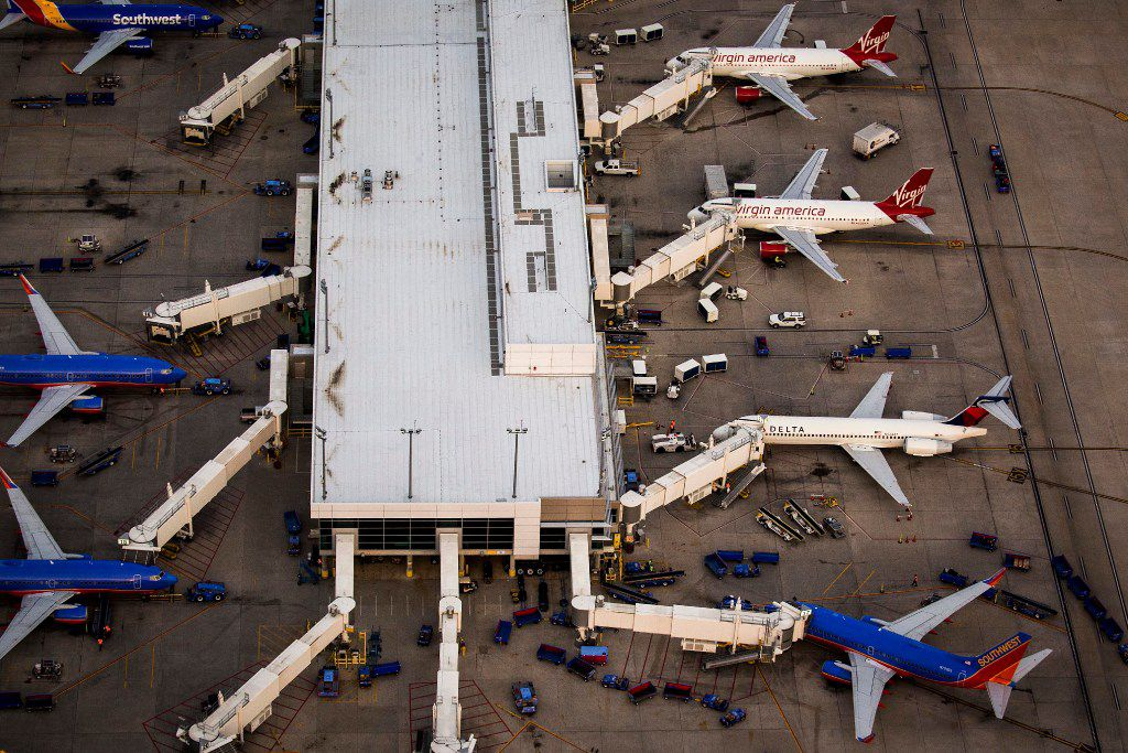 Virgin America, Delta and Southwest airplanes at the gates of Dallas Love Field on Monday, March 6, 2017, in Dallas, Texas. (Smiley N. Pool/The Dallas Morning News)