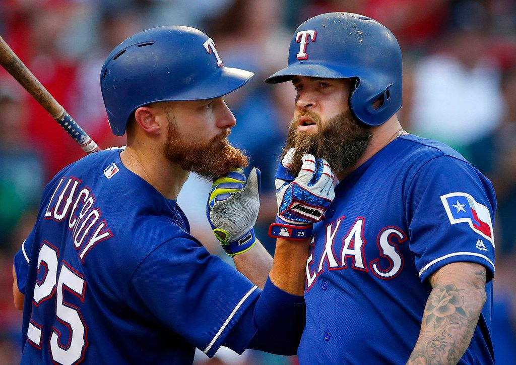 Texas Rangers Mike Napoli (right) and teammate Jonathan Lucroy (25) pull on each others bears after Napoli hit a third inning home run against the Miami Marlins at Globe Life Park in Arlington, Tuesday, July 25, 2017. (Tom Fox/The Dallas Morning News)