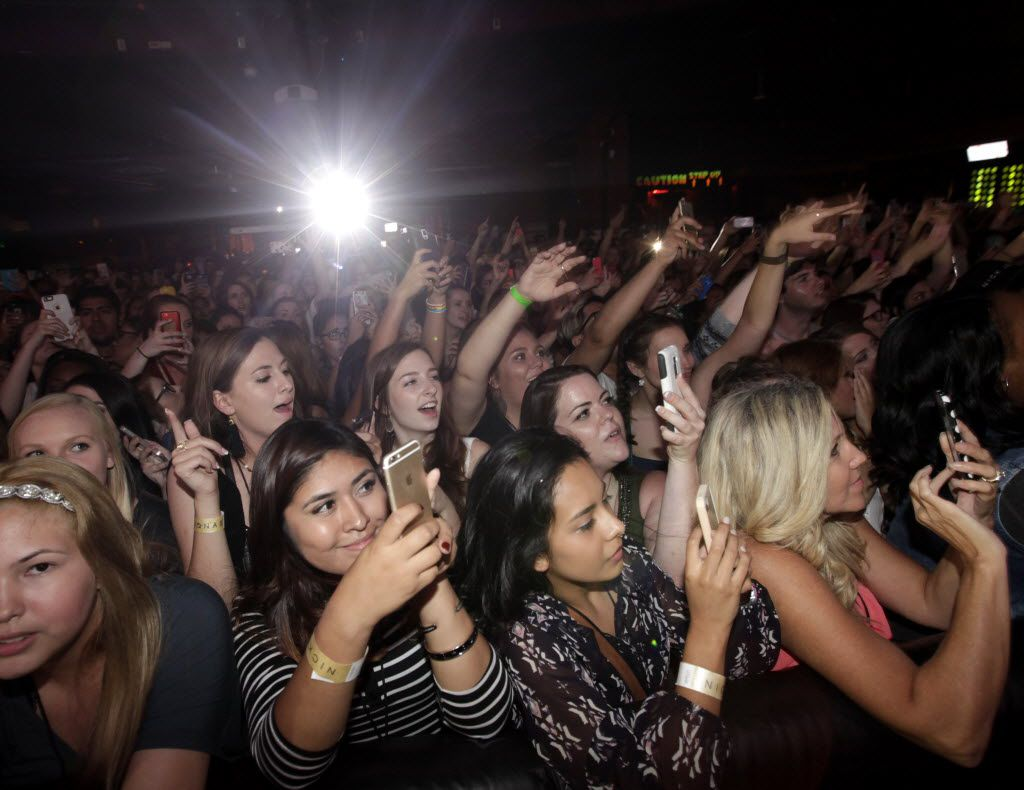 Fans cheer as Nick Jonas performs at House of Blues in Dallas, TX, on Sep. 23, 2015.