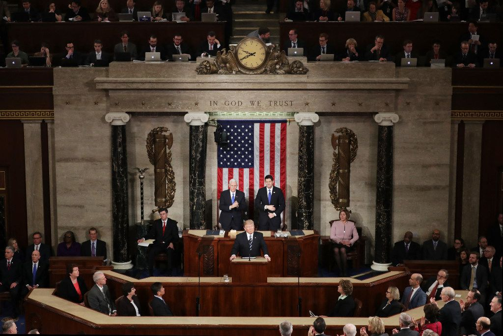 U.S. President Donald Trump addresses a joint session of the U.S. Congress as Vice President Mike Pence (L) and House Speaker Rep. Paul Ryan (R) (R-WI) look on on February 28, 2017 in the House chamber of  the U.S. Capitol. (Photo by Chip Somodevilla/Getty Images)
