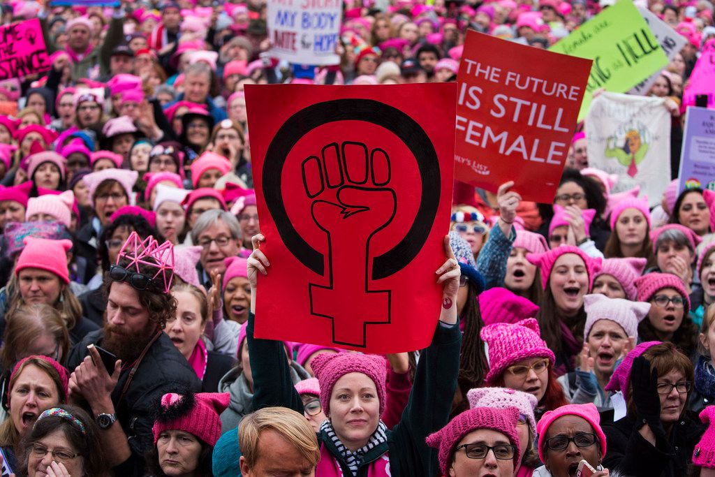 Demonstrators take part in the Women's March in Washington, Jan. 21, 2017. A year after women took to the streets en masse to protest President Donald Trump's inauguration, marchers gathered again in 2018 in hundreds of cities across the country and the world. (Ruth Fremson/The New York Times)