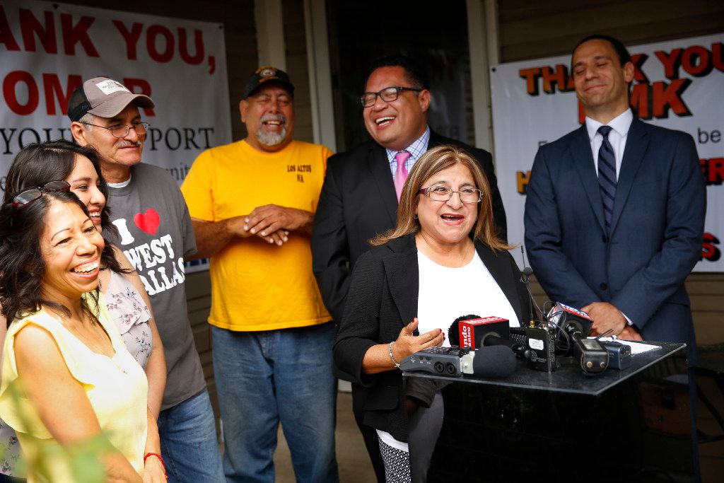 LULAC's Hilda Duarte jokes with HMK landlord Khraish Khraish during a press conference where Khraish announced he's changing his mind and deciding to sell homes to his West Dallas tenants. Khraish said Duarte is one of three people that convinced him to change his mind.