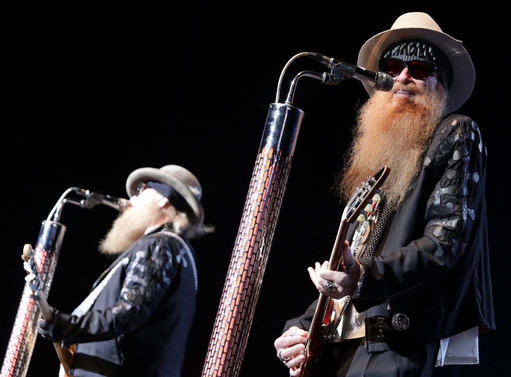 Dusty Hill (left) and Billy Gibbons of ZZ Top perform at Toyota Music Factory in Irving on Saturday.