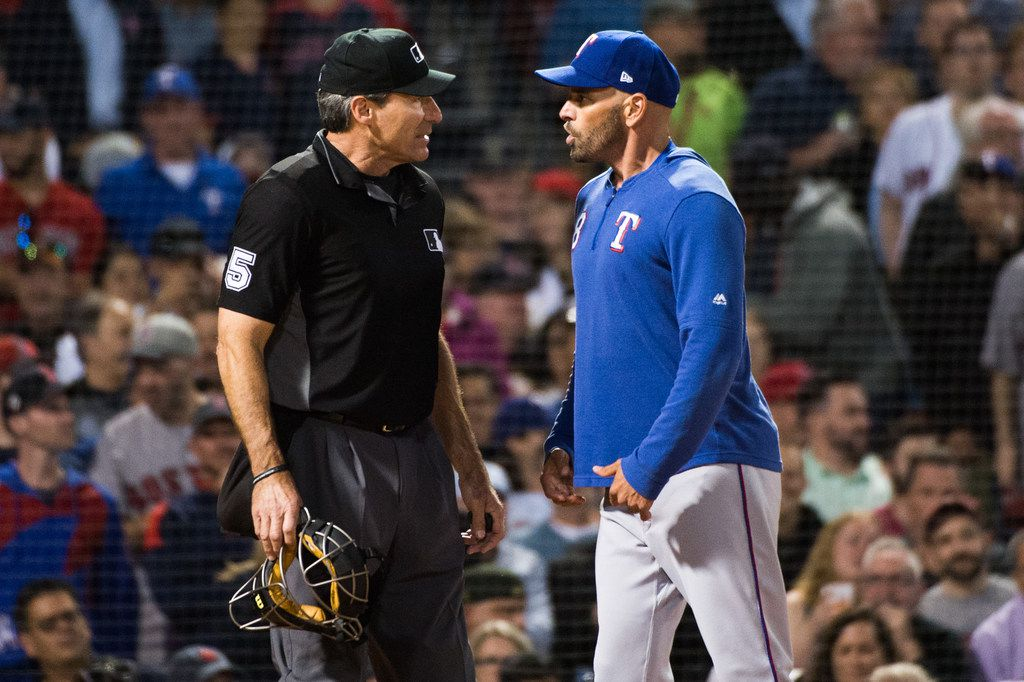 BOSTON, MA - JUNE 11:  Texas Rangers manager Chris Woodward #8 argues with home plate umpire Angel Hernandez after being ejected in the sixth inning against the Boston Red Sox at Fenway Park on June 11, 2019 in Boston, Massachusetts. (Photo by Kathryn Riley /Getty Images)