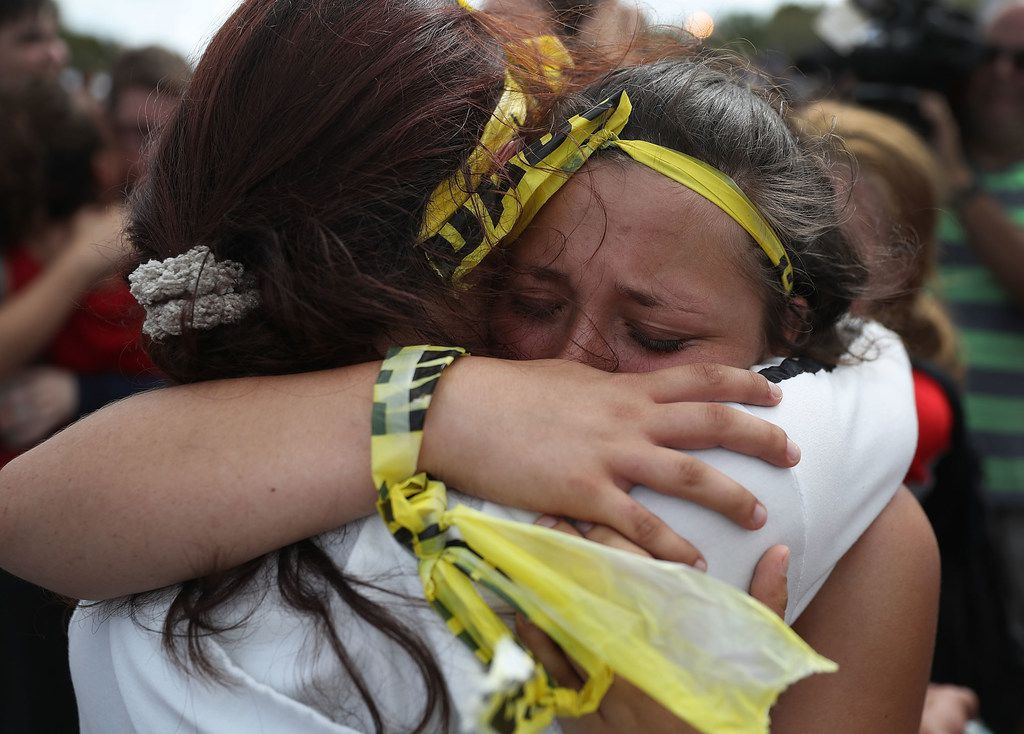 Madison Fox is hugged as the West Boca High School student joined hundreds of fellow students that walked to Marjory Stoneman Douglas High School in honor of the 17 students shot dead last week on February 20, 2018 in Parkland, Florida. Police arrested 19-year-old former student Nikolas Cruz for killing 17 people at the high school.