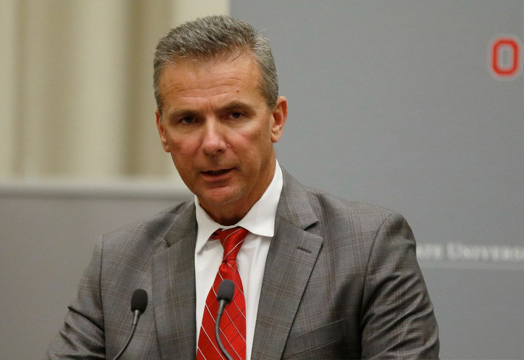 Ohio State football coach Urban Meyer makes a statement during a press conference in Columbus, Ohio, Wednesday, Aug. 22, 2018, to announce the results of an investigation of NCAA college football coach Urban Meyer for the way he handled domestic-abuse allegations against a former assistant. Ohio State suspended Meyer on Wednesday for three games for mishandling domestic violence accusations, punishing one of the sport's most prominent leaders for keeping an assistant on staff for several years after the coach's wife accused him of abuse. (AP Photo/Paul Vernon)