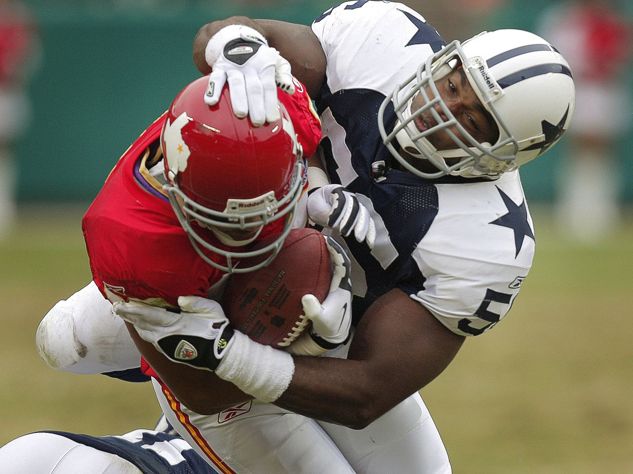 Dallas Cowboys linebacker Bradie James tackles Kansas City Chiefs receiver Bobby Wade during an October 2009 game at Arrowhead Stadium in Kansas City, Mo. The throwback uniforms the Chiefs wore that day dated back to the franchise's origin as the Dallas Texans in the early 1960s.