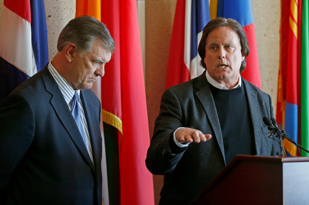 Mayor Mike Rawlings (left) listens to David R. Carey, Executive Vice President of T-Mobile, speaking during a press conference about the 911 issue with T-Mobile at Dallas City Hall on Wednesday, March 15, 2017, in Dallas. (Jae S. Lee/The Dallas Morning News)