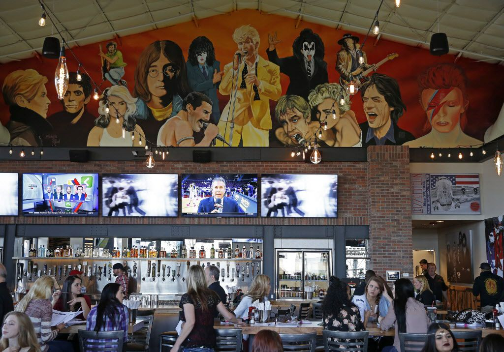 The bar and a large mural at Rock & Brews in The Colony, Texas, Tuesday, March 8, 2016. (Jae S. Lee/The Dallas Morning News)