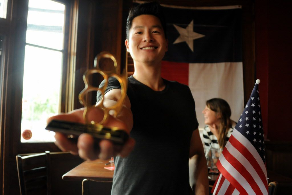 Any Chu wins first place at the 7th annual Brass Knuckles Corn Dog Beatdown at The Libertine Bar on July 4, 2015.