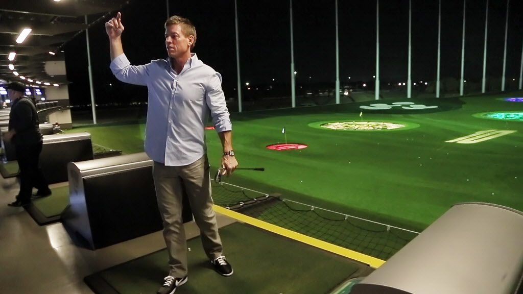 Former Dallas Cowboys quarterback Troy Aikman reacts after making a good tee-shot during the grand opening of the Top Golf in The Colony, Monday, November 18, 2013. (BRANDON WADE/Special Contributor)