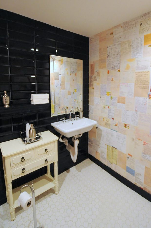 Beck family recipe wallpaper wraps the walls in the bathroom at Pink Magnolia in Oak Cliff.