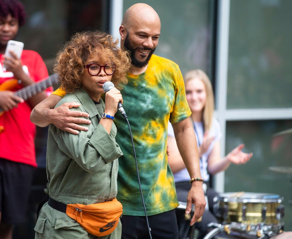 Rapper Common embraces singer Erykah Badu as they sing at Booker T. Washington High School for the Performing and Visual Arts in Dallas on Wednesday, August 28, 2019. (Shaban Athuman/Staff Photographer)