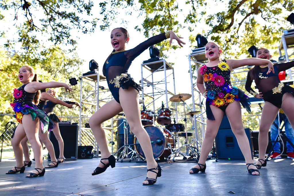 Children with the Alianza Rumbera Dance School performed during the Texas Latino Pride festival last fall at Reverchon Park in Dallas.
