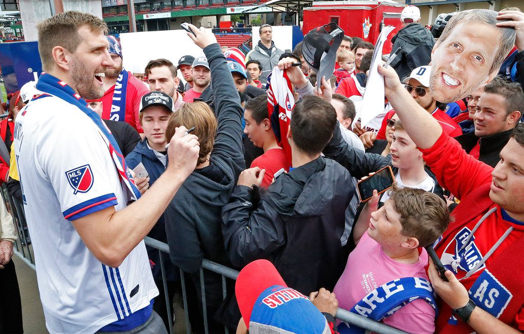 Dirk Nowitzki signs autographs before the start of the game as FC Dallas hosted the New York Red Bulls at Toyota Stadium in Frisco on Saturday, May 11, 2019.  (Stewart F. House/Special Contributor)