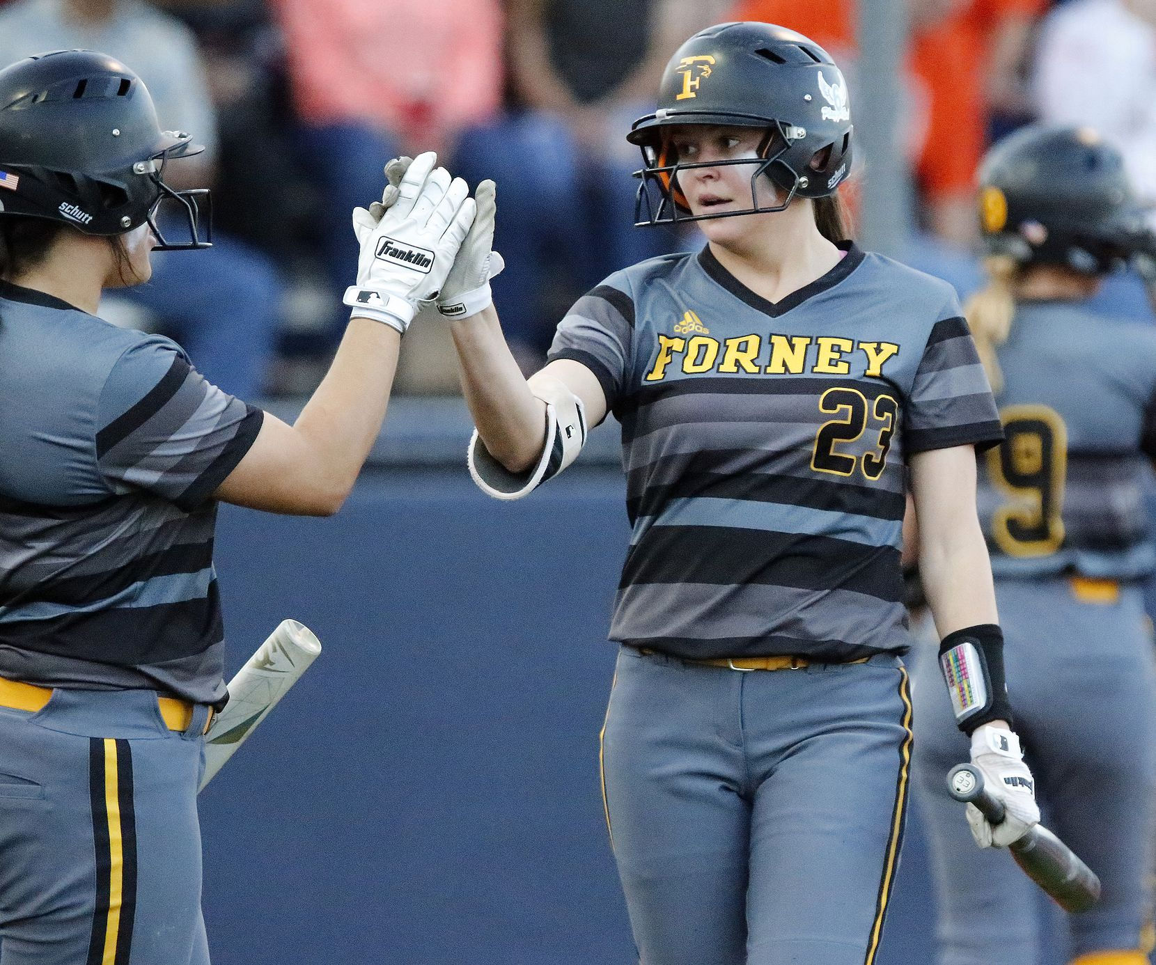 Forney shortstop Caleigh Cross (23) is congratulated by Trinity Cannon (left) after Cross scored in the third inning as McKinney North High School played Forney High School in the second game of a three game series to determine the Class 5A Region II semifinals on Friday, May 17, 2019.  (Stewart F. House/Special Contributor)