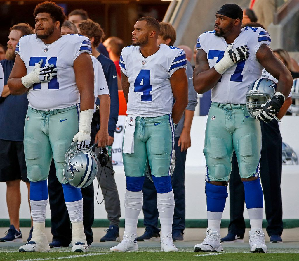 From left, Dallas Cowboys offensive tackle La'el Collins (71), quarterback Dak Prescott (4) and offensive tackle Tyron Smith (77) stand during the national anthem during the pre-season game against San Francisco 49ers at Levi's Stadium in Santa Clara, Calif., Thursday, Aug. 9, 2018. (Jae S. Lee/The Dallas Morning News)
