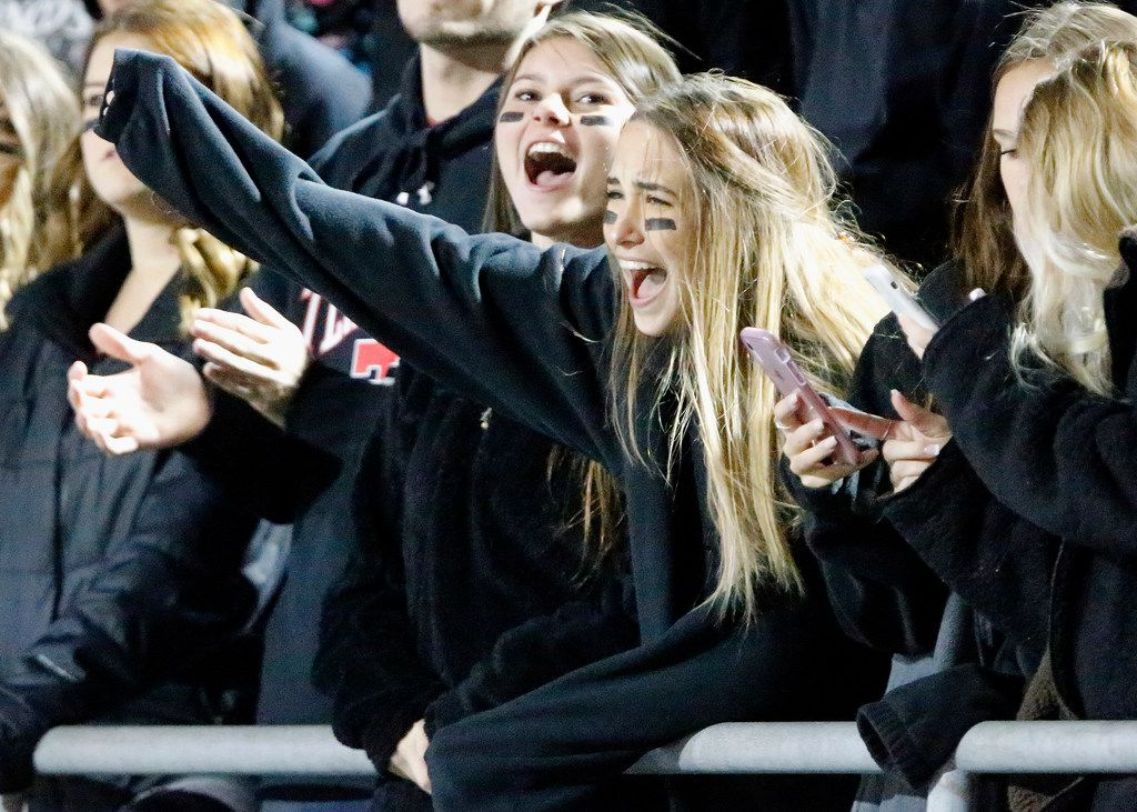 McKinney Boyd High School students Amelia Ziegler (right) and Addi Hogue cheer a score during the first half as Plano West High School hosted McKinney Boyd High School at Clark Stadium in Plano on Friday night, October 11, 2019. (Stewart F. House/Special Contributor)