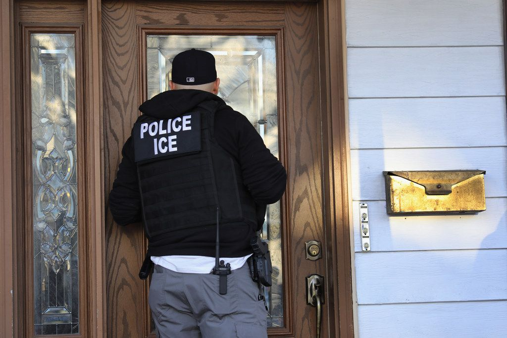 """NEW YORK, NY - APRIL 11:  U.S. Immigration and Customs Enforcement (ICE), officers arrive to a Flatbush Gardens home in search of an undocumented immigrant on April 11, 2018 in the Brooklyn borough of New York City. ICE's Enforcement and Removal Operations division primarily arrests immigrants for invalid immigration status, usually leading to their deportation. New York is considered a """"sanctuary city"""" for undocumented immigrants, and ICE receives little or no cooperation from local law enforcement.  (Photo by John Moore/Getty Images)"""