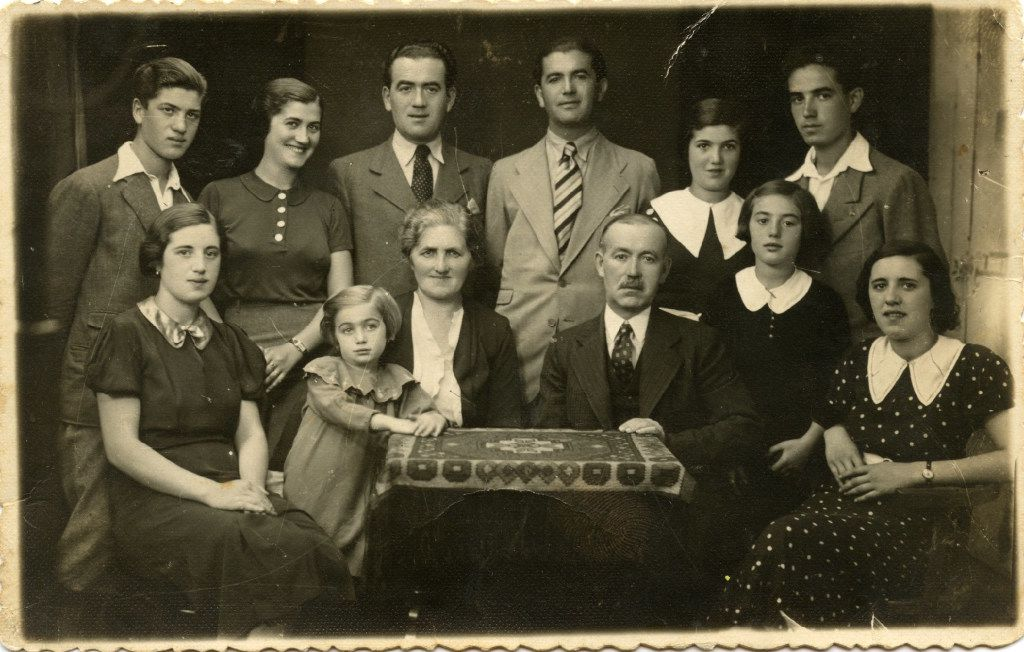The Sternberg family in 1935 or 1936 during Passover in Munk cs, the last time the entire immediate family was all together. Top row, from left: Wilmos, Lily, Marcel, Moric, Claire, Eugene. Bottom row, from left: Aranka, Magda, Franceska, Julius, Hansi, Shari. Names in bold are the four sisters who survived the Holocaust together. Aranka, Julius, Franceska, Shari and Shari's young daughter, Fritzi, were all killed at Auschwitz