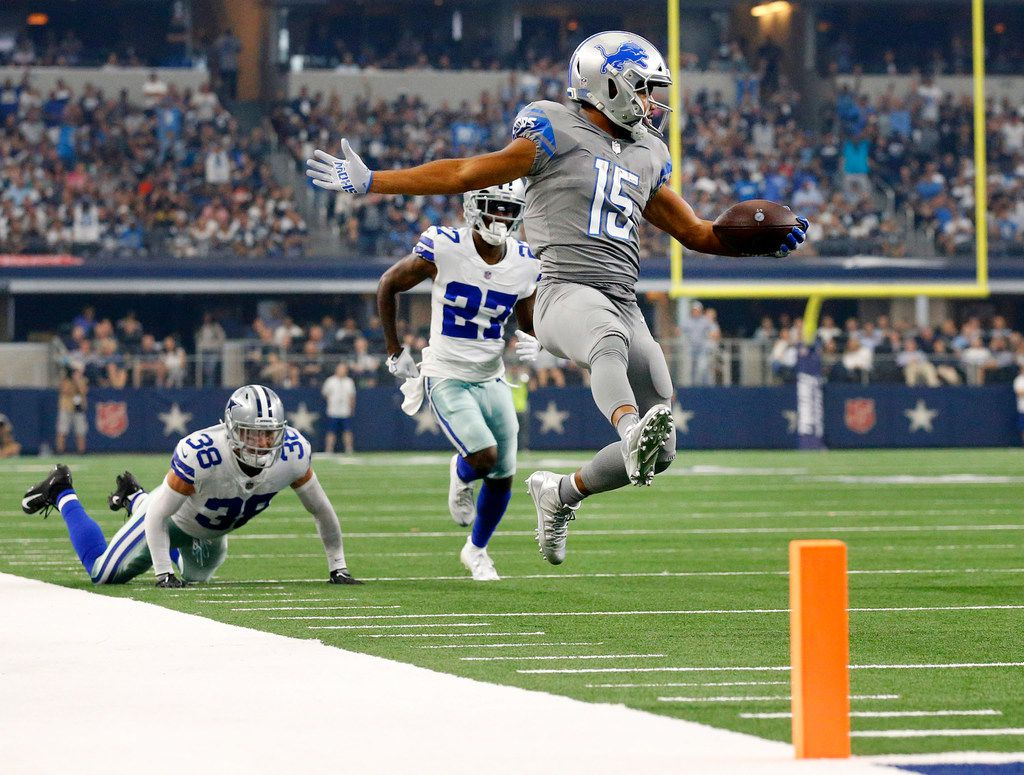 Detroit Lions wide receiver Golden Tate (15) skips to the end zone before stopping and stepping backwards over the line during the first quarter at AT&T Stadium in Arlington, Texas, Sunday, September 30, 2018. Chasing on the play are Dallas Cowboys defensive back Jeff Heath (38) and cornerback Jourdan Lewis (27). (Tom Fox/The Dallas Morning News)