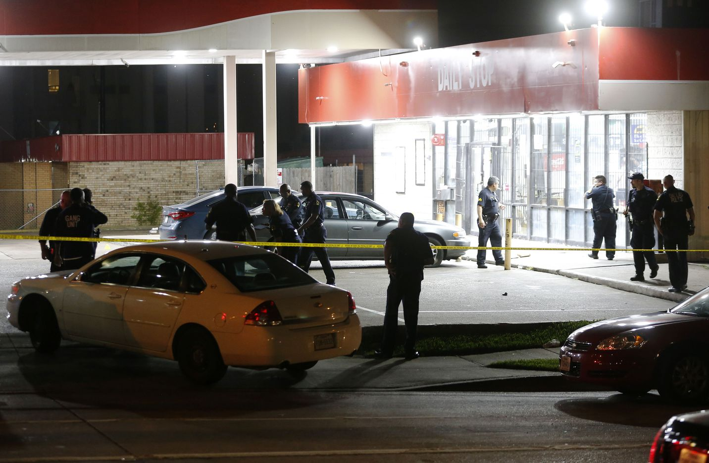 Dallas police investigate the scene of a shooting where a 13-year-old boy died after being caught in crossfire near a Pleasant Grove gas station in the 9400 block of Bruton Avenue in Dallas on June 4, 2019.