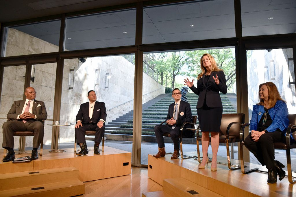 Mayoral candidate Lynn McBee, second from right, stands as she speaks about the issues facing the arts in Dallas communities at the Dallas Mayoral Arts and Cultural Forum held at the Nasher Sculpture Center in Dallas, Monday March 25, 2019.