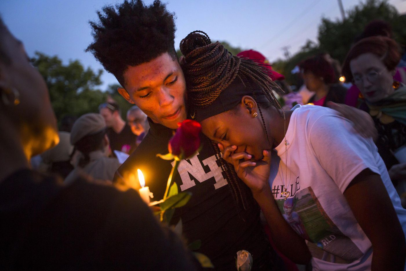 """Ashuntae Coleman, 14, is consoled by De'Juan Johnson, 15, during the """"Remember His Name: Vigil for Jordan Edwards"""" candlelight vigil at Virgil T. Irwin Park on Thursday, May 4, 2017, in Balch Springs, Texas."""