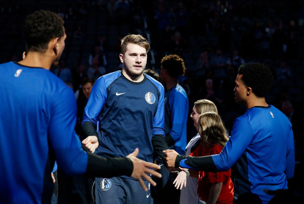 FILE - Dallas Mavericks guard Luka Doncic (77) makes his way onto the court as he is introduced before a preseason game against the Charlotte Hornets at American Airlines Center in Dallas on Friday, October 12, 2018. (Vernon Bryant/The Dallas Morning News)
