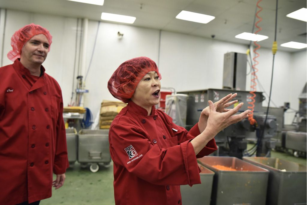 Van's Kitchen's Carl Motter, chief sales officer, and Theresa Motter, chief executive officer, conduct a tour of their egg roll production plant in Dallas,
