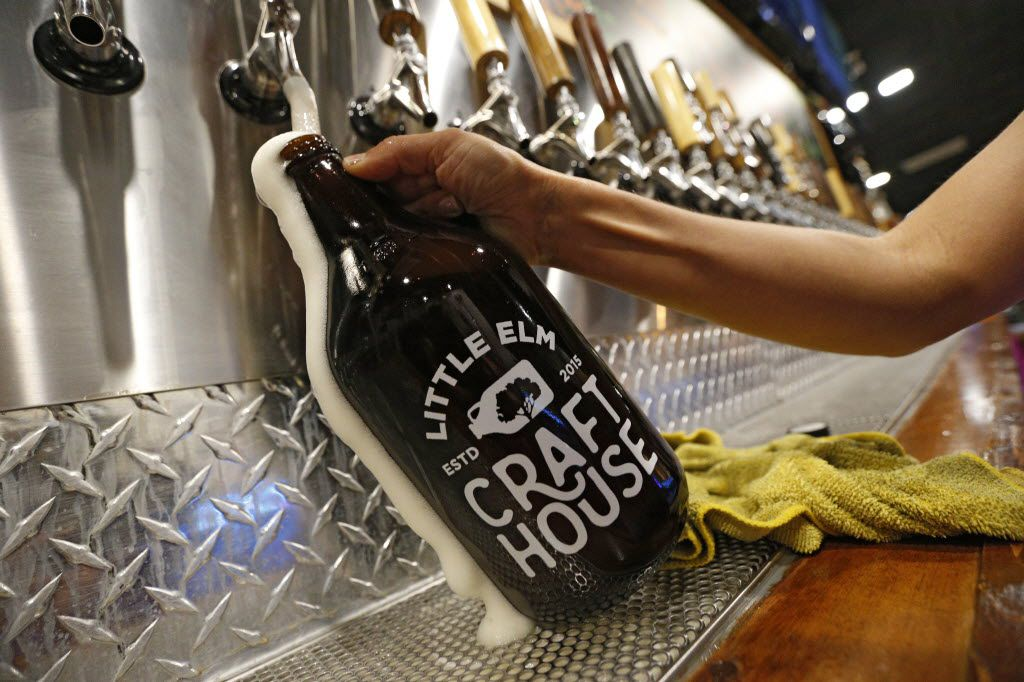 A growler is filled at Little Elm Crafthouse in Little Elm, Texas Aug. 30, 2016.