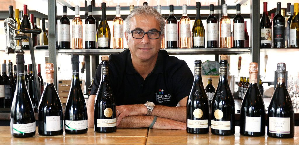 Daniele Puleo, chef-owner of CiboDivino Marketplace in Dallas, with a variety of Lambrusco wines.