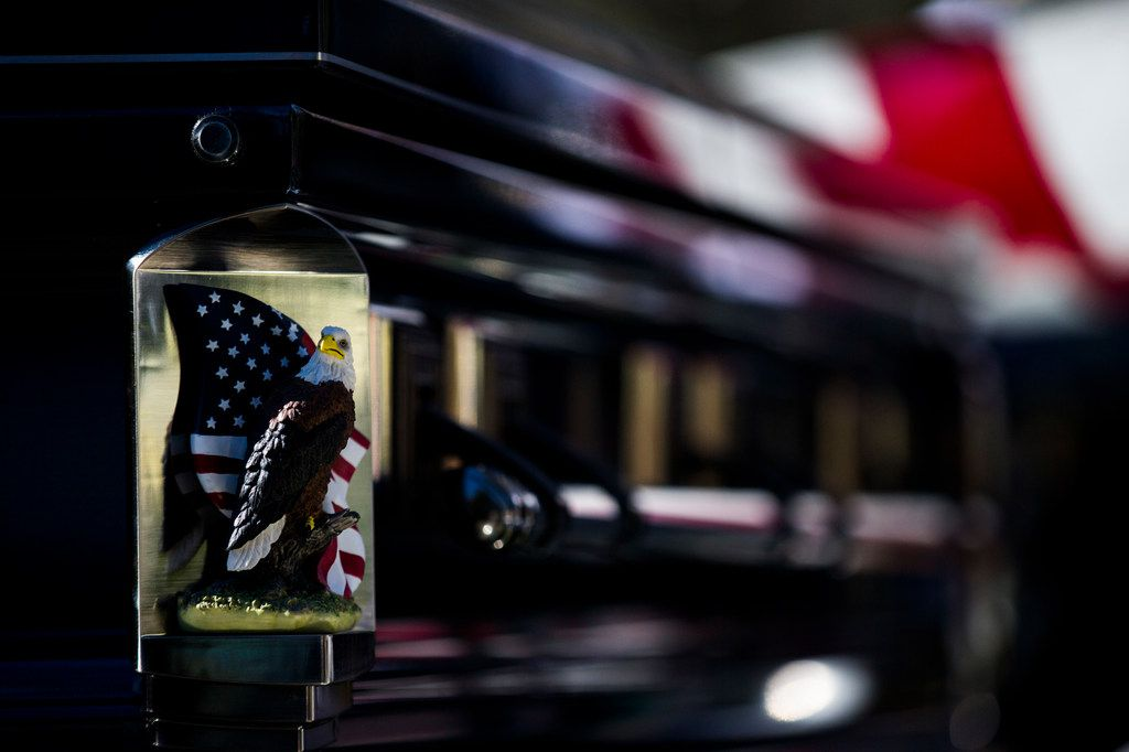 A bald eagle and an American flag are displayed on each corner of the casket of Richard Overton during a graveside service on Saturday, Jan. 12, 2019, in Austin. Overton was the oldest living veteran and oldest living male at 112 years old until he died on Dec. 27, 2018. He was known for drinking whiskey and smoking cigars on his front porch in East Austin.