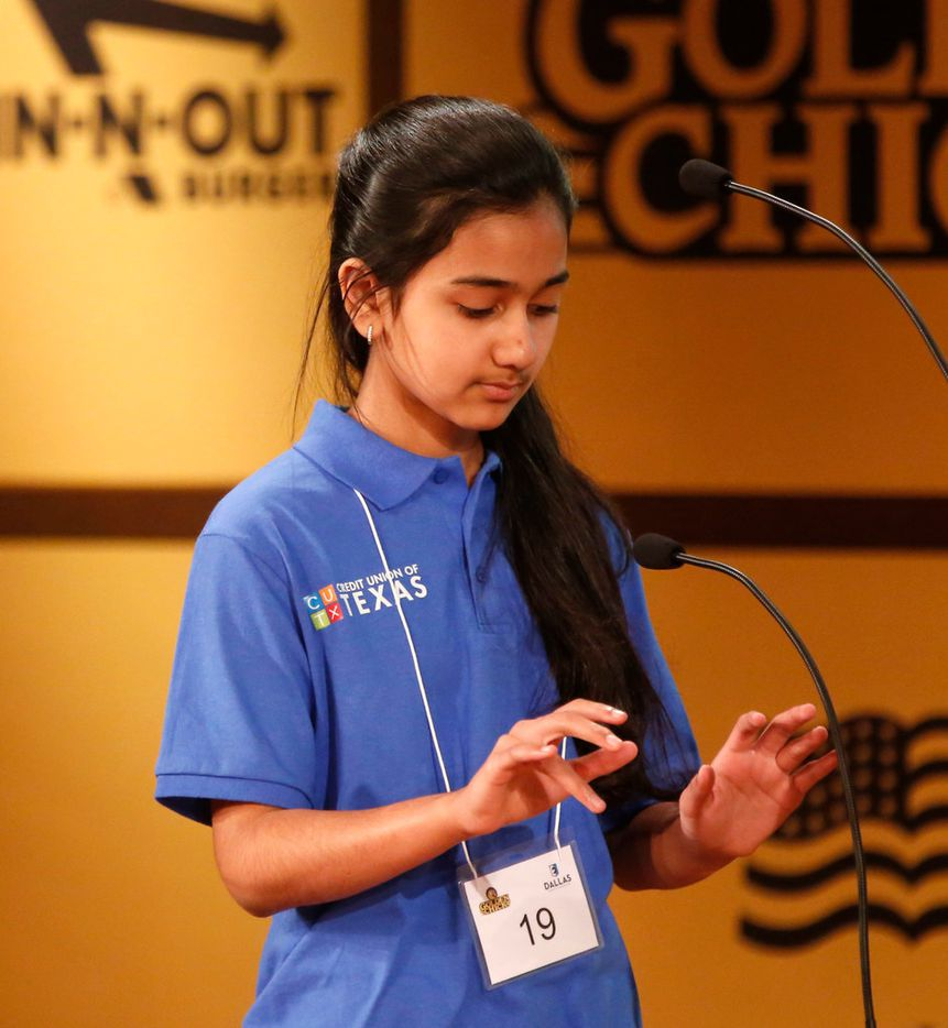 Naysa Modi of Collin County spells out words on an imaginary keyboard. (Rose Baca/The Dallas Morning News)