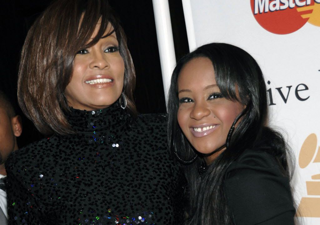 In this Feb. 12, 2011, file photo, singer Whitney Houston, left, and daughter Bobbi Kristina Brown arrive at an event in Beverly Hills, Calif. Brown. (AP Photo/Dan Steinberg, File) 07292015xPUB