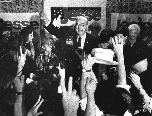 Sen. Jesse Helms, R-N.C., gives the thumbs-up to his supporters at the Brownstone Hotel during his victory speech on Nov. 6, 1990.