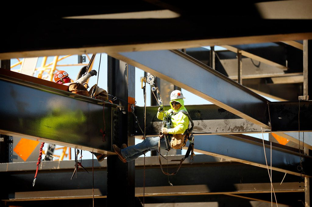 Construction workers work on support beams in the upper concourse of the new Globe Life Field under construction in Arlington, Texas, Tuesday, September 18, 2018. The Texas Rangers and Manhattan Construction celebrated the One Million Man Hours by providing a barbecue lunch for its nearly 900 construction workers.