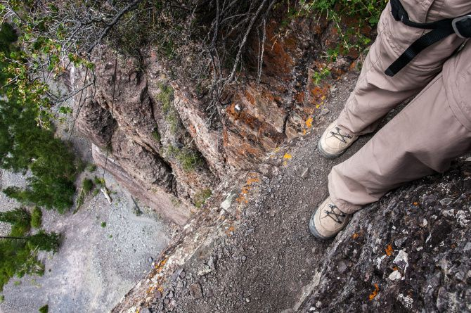 Telluride's Via Ferrata follows a ledge that is less than a foot wide in places.  Hikers find the view down from spots like this to be either scary or mesmerizing.