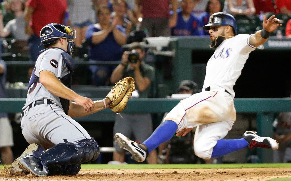 Texas Rangers second baseman Rougned Odor (12) is out at home as Detroit Tigers first baseman John Hicks (55) makes the tag to end the eighth inning during the Detroit Tigers vs. the Texas Rangers major league baseball game at Globe Life Park in Arlington on Tuesday, August 15, 2017. (Louis DeLuca/The Dallas Morning News)