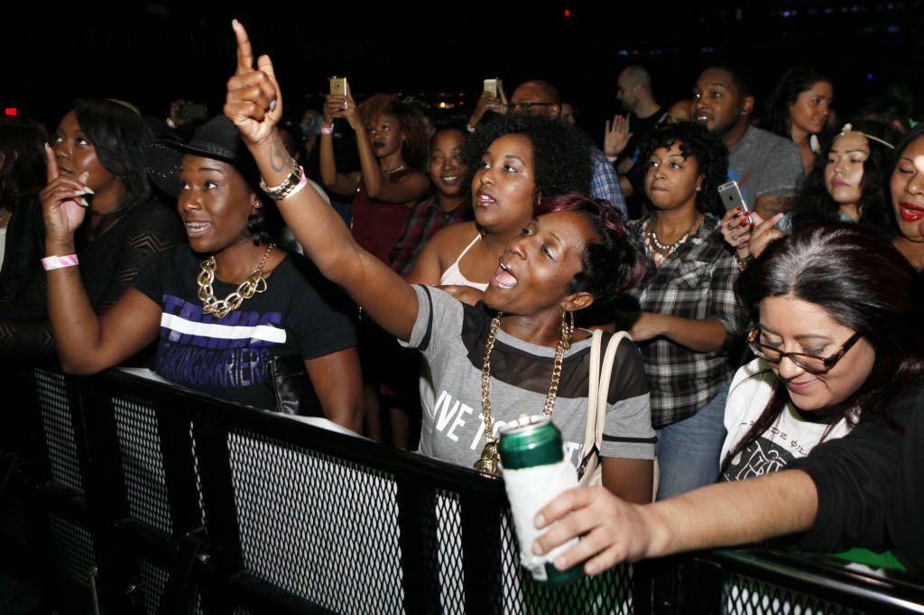 Rap fan Crystal Holmes, center, dances to the sounds of rapper Fat Pimp during his performance at The D.O.C. Straight Outta Dallas Hip Hop event, on Saturday, Oct. 17, 2015 at The Bomb Factory in Dallas. The event included a red carpet, DJ music and performances by A.Dd+, Big Tuck, Erykah Badu and The D.O.C.