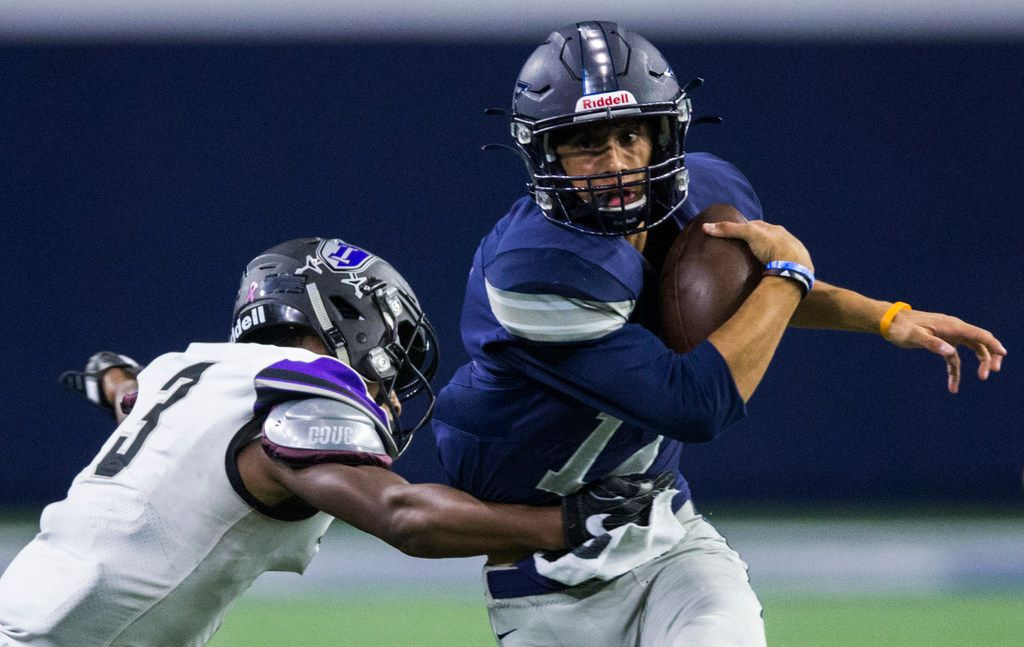 Frisco Lone Star quarterback Dylan Deleon (14) is tackled by Frisco Independence linebacker Kendall Williams (3) during the first quarter of a District 5-5A Division I high school football game between Frisco Independence and Frisco Lone Star on Thursday, October 10, 2019 at the Ford Center at The Star in Frisco. (Ashley Landis/The Dallas Morning News)