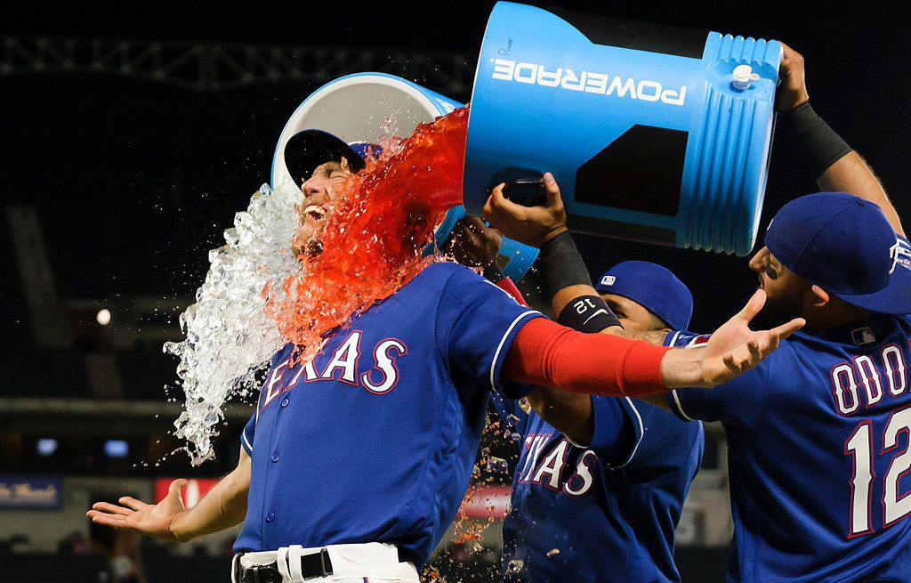 Texas Rangers outfielder Hunter Pence is doused with Powerade by shortstop Elvis Andrus and second baseman Rougned Odor after a victory over the Houston Astros at Globe Life Park on Wednesday, April 3, 2019, in Arlington.
