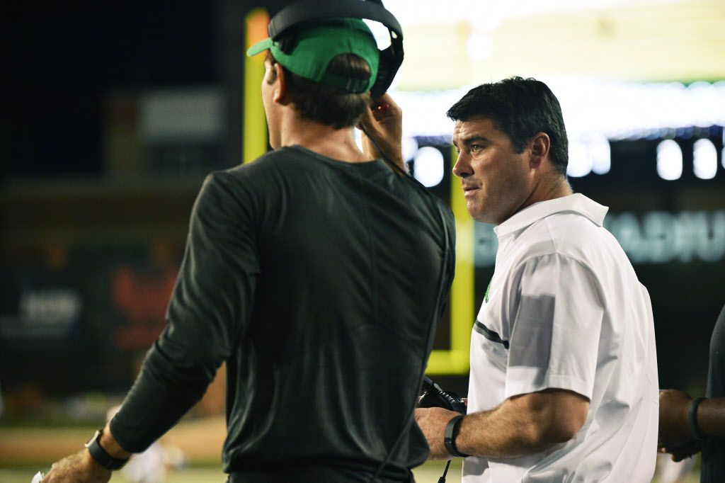 North Texas head coach Seth Littrell talks with offensive coordinator Graham Harrell on the sideline against Southern Methodist, Saturday, September 3, 2016, at Apogee Stadium in Denton, Texas. David Minton/DRC