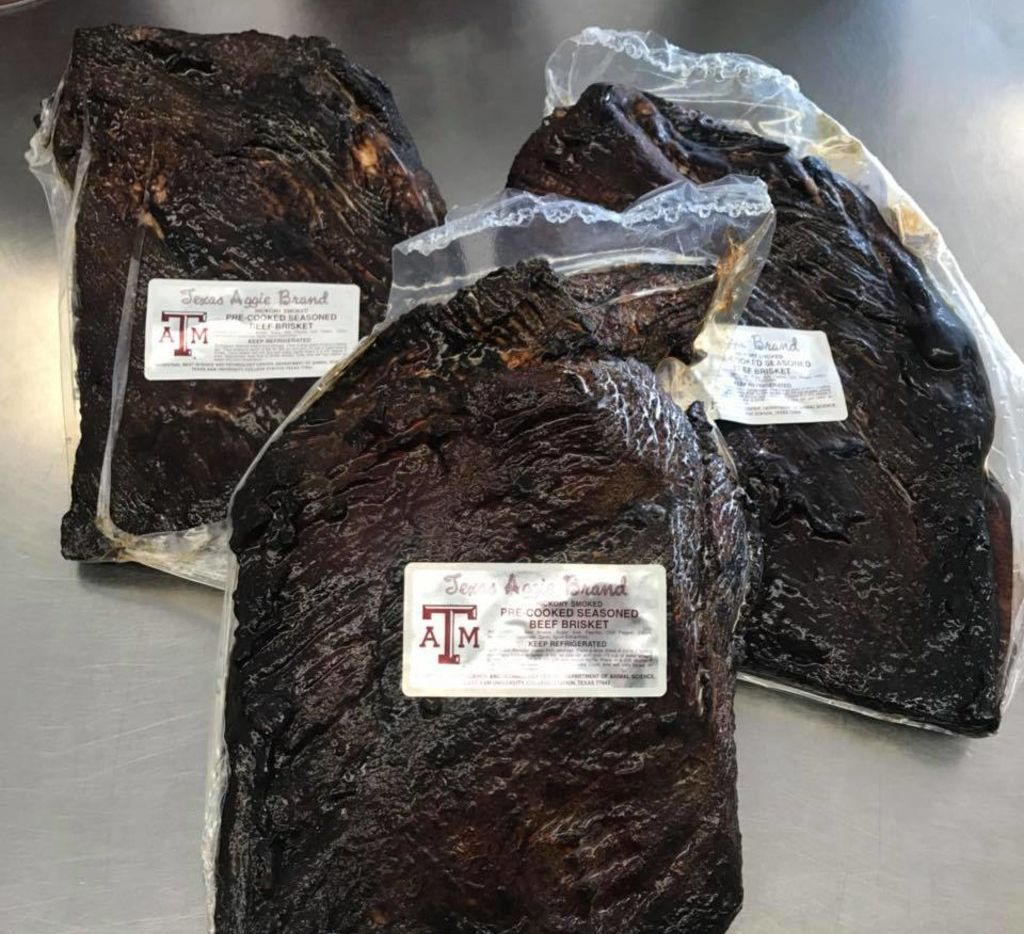 You can order a Texas Aggie Brand fully cooked brisket for overnight delivery.