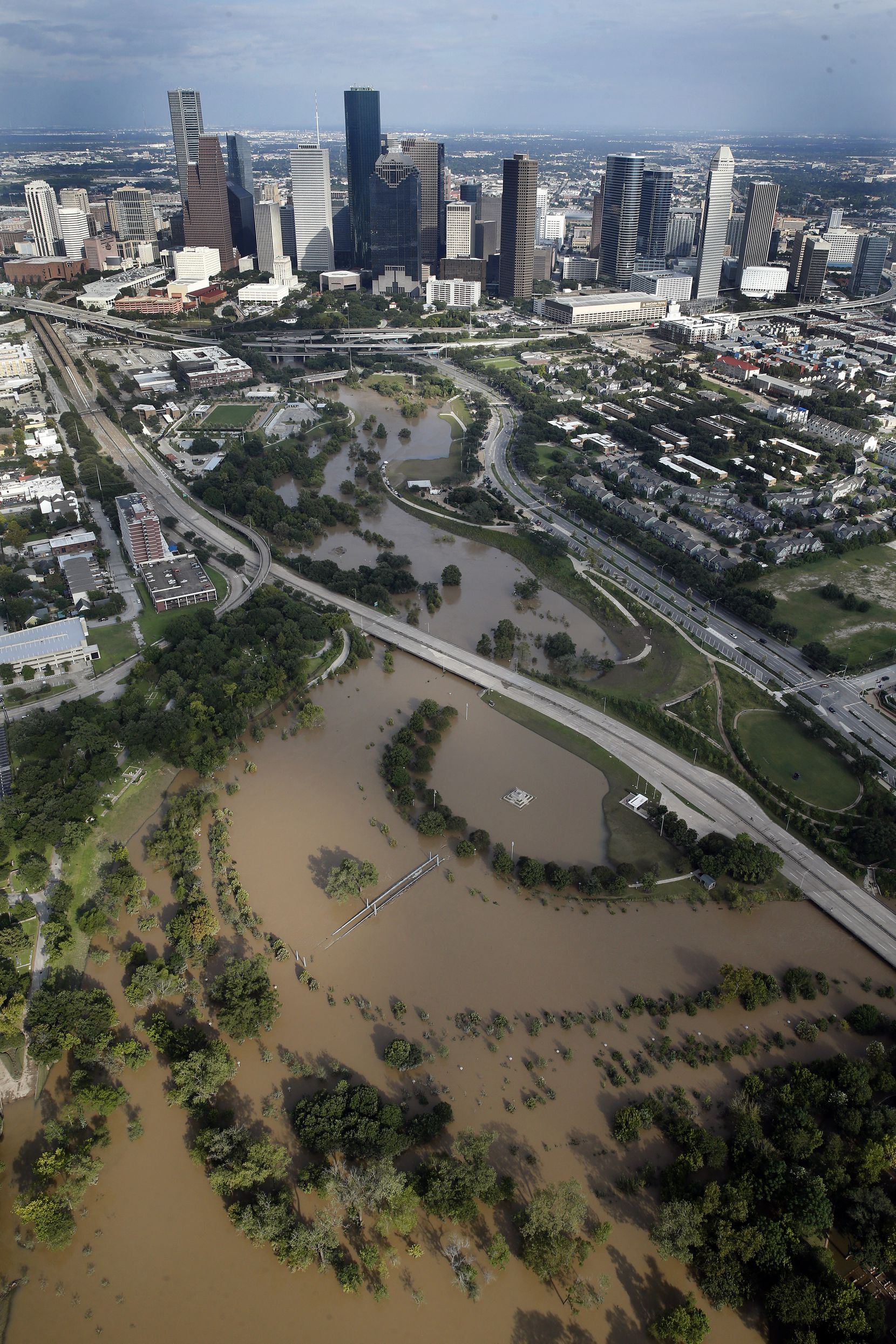 The swollen Buffalo Bayou is pictured in front of the Houston, Texas skyline, Wednesday, August 30, 2017.
