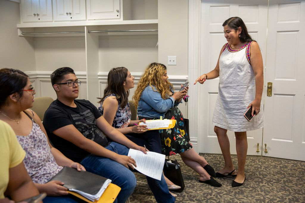 Emma Chalott Barron speaks with participants in a free Deferred Action for Childhood Arrivals renewal workshop hosted by the North Texas Dream Team in Dallas.