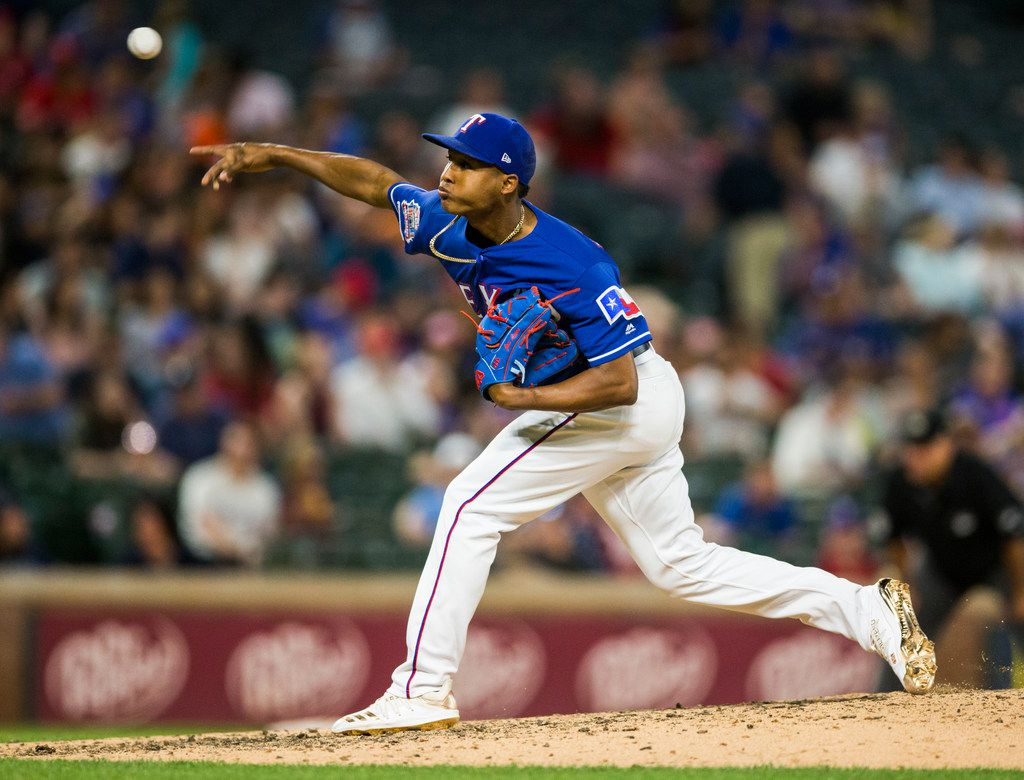 Texas Rangers relief pitcher Jose Leclerc (25) pitches during the eighth inning of an MLB game between the Texas Rangers and the Seattle Mariners on Tuesday, May 21, 2019 at Globe Life Park in Arlington. (Ashley Landis/The Dallas Morning News)