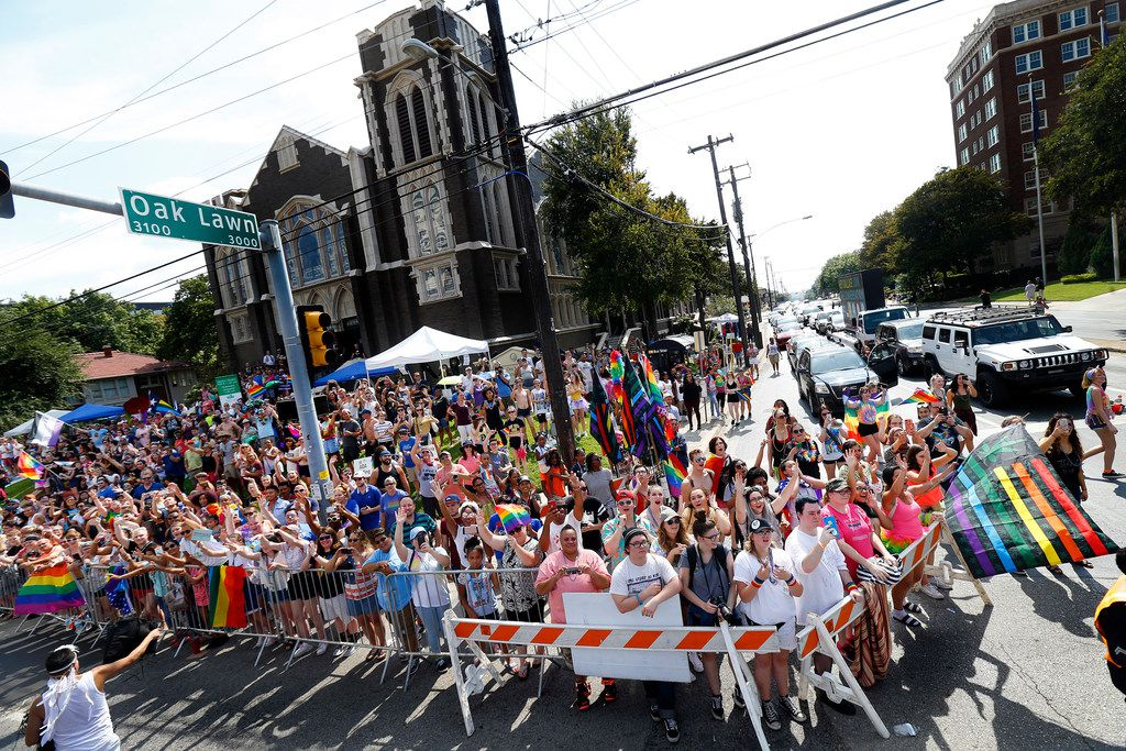 Large crowds gathered along Cedar Springs Road and Oak Lawn during the Alan Ross Texas Freedom Parade, Dallas' annual LGBTQ pride celebration.