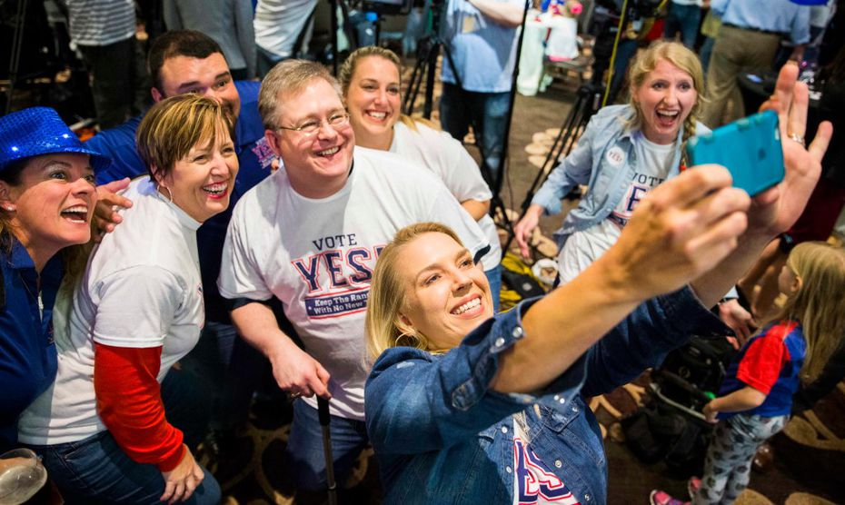 Andrea Proctor takes a selfie as supporters of a proposed new stadium for the Texas Rangers celebrate as they realized a referendum on Nov, 8 would pass.  (Ashley Landis/The Dallas Morning News)