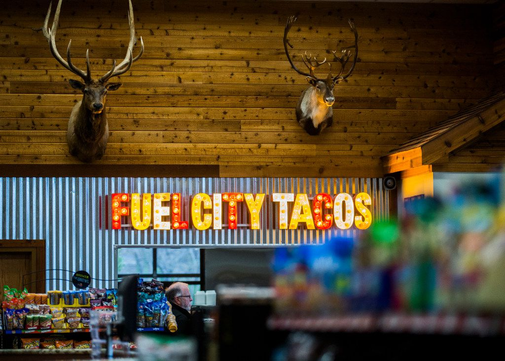 Heads of animals are displayed over the taco window at a new Fuel City location on Friday, December 16, 2016 on Haltom Road in Haltom City. (Ashley Landis/The Dallas Morning News)
